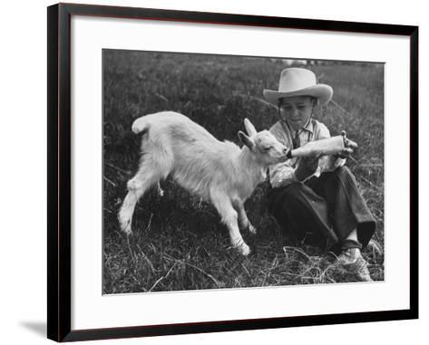 Little White Goat Being Fed from Bottle by Little Boy, at White Horse Ranch-William C^ Shrout-Framed Art Print