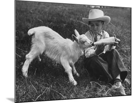 Little White Goat Being Fed from Bottle by Little Boy, at White Horse Ranch-William C^ Shrout-Mounted Photographic Print