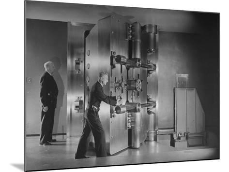 Guards Closing Bank Vault Door at Irving Trust Company-Herbert Gehr-Mounted Photographic Print