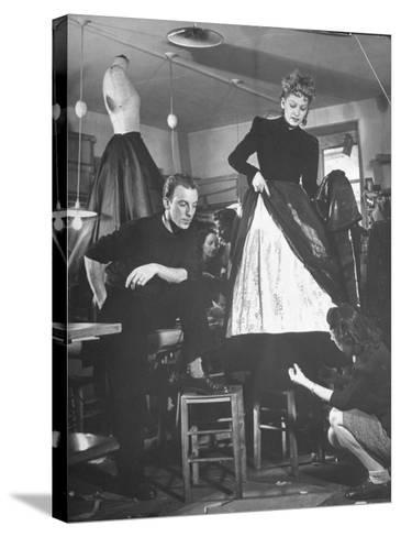 Jacques Fath Watching as the Tailor Hymns the Loose Ends at the Bottom of the Dress-Nina Leen-Stretched Canvas Print