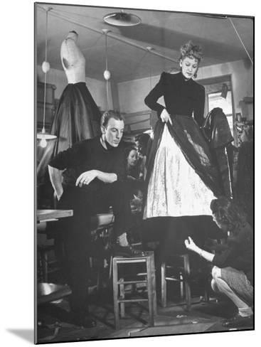 Jacques Fath Watching as the Tailor Hymns the Loose Ends at the Bottom of the Dress-Nina Leen-Mounted Premium Photographic Print