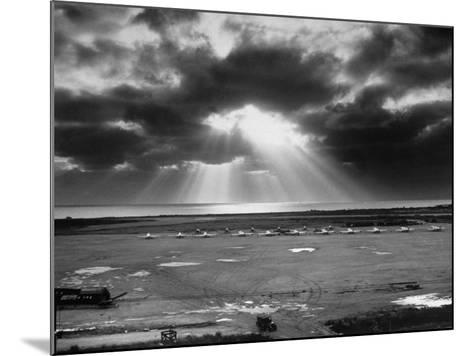 Sunset Breaking on Us Airbase across the East China Sea from Mainland China-Carl Mydans-Mounted Photographic Print