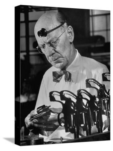 Pistol Engraver Harry Jarvis Disassembling Revolver at Smith and Wesson's Gunmaking Plant-Margaret Bourke-White-Stretched Canvas Print