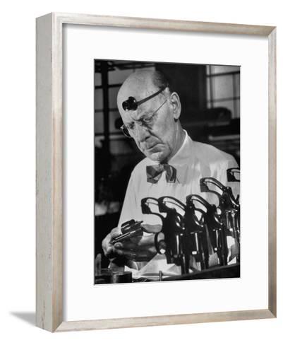 Pistol Engraver Harry Jarvis Disassembling Revolver at Smith and Wesson's Gunmaking Plant-Margaret Bourke-White-Framed Art Print