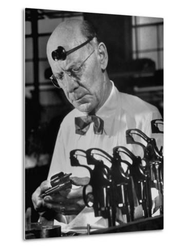 Pistol Engraver Harry Jarvis Disassembling Revolver at Smith and Wesson's Gunmaking Plant-Margaret Bourke-White-Metal Print