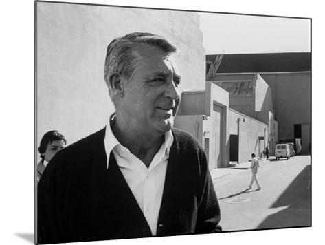 Actor Cary Grant on Lot at Universal Studio-John Dominis-Mounted Premium Photographic Print