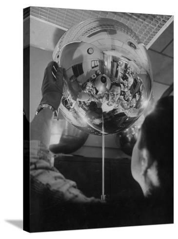 Scientist Alexander Simkovich Working on a Us Artificial Satellite-Hank Walker-Stretched Canvas Print