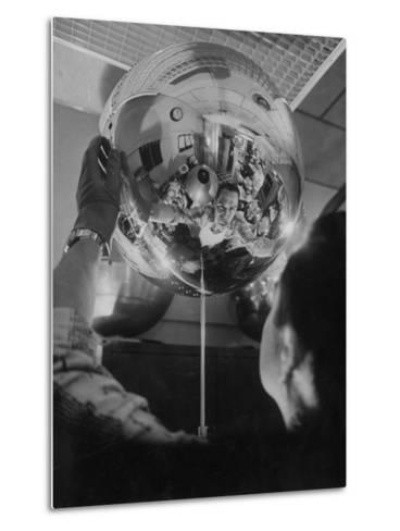 Scientist Alexander Simkovich Working on a Us Artificial Satellite-Hank Walker-Metal Print
