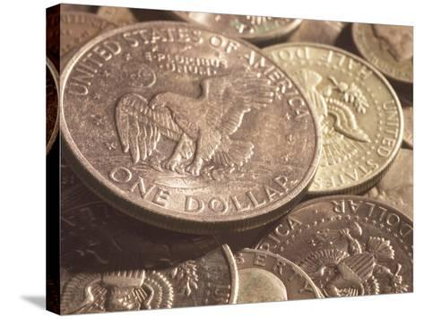 Close-Up of American Silver Dollar Coin with Eagle on its Face with Other Coins--Stretched Canvas Print