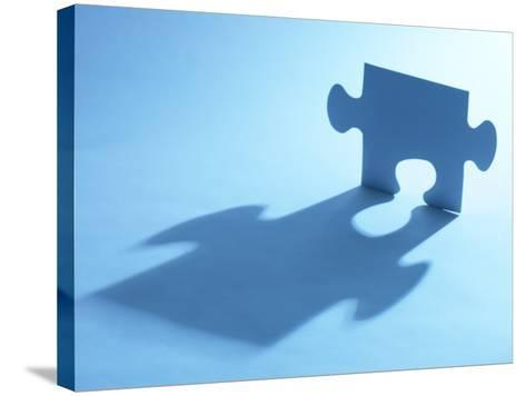 Standing Blue Puzzle Piece with Shadow in Blue Light--Stretched Canvas Print