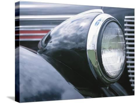Reflective Chrome Headlight in Antique Black Car--Stretched Canvas Print