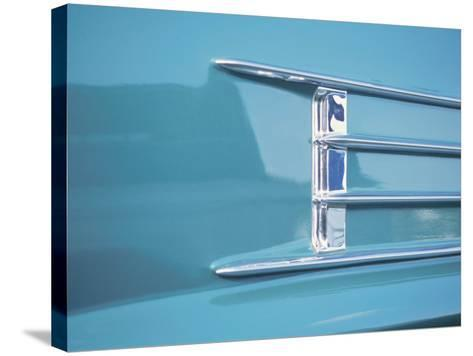 Detail of a Shiny Chrome Decoration on a Vintage Blue Car--Stretched Canvas Print