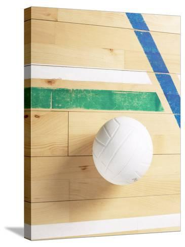 View of Volleyball on Wooden Gymnasium Floor--Stretched Canvas Print