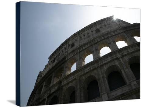 Sun Shining Through Ruins of the Coliseum, Rome, Italy--Stretched Canvas Print