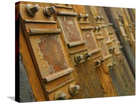 Close-Up of Rustic Metal Pieces Lined Up in a Organized Fashion--Stretched Canvas Print