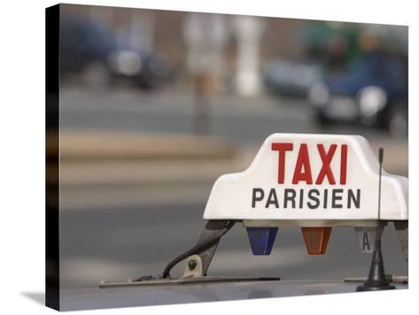 Close-Up of Sign on Roof of Taxi in Paris, France--Stretched Canvas Print