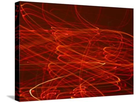 Abstract Motion Blur Pattern of Red Lights Swirling--Stretched Canvas Print