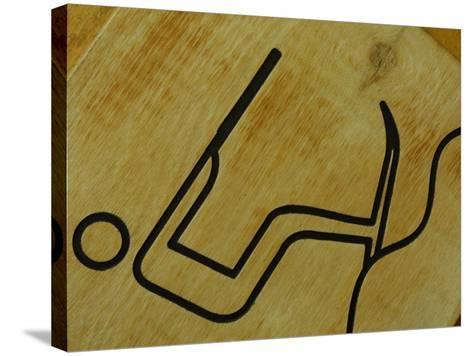 Close-Up of Wooden Tile with Water Skiing Figure--Stretched Canvas Print