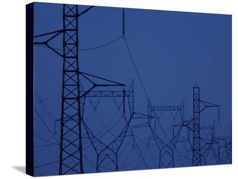 Silhouette of Towers with High Voltage Power Lines at Twilight--Stretched Canvas Print