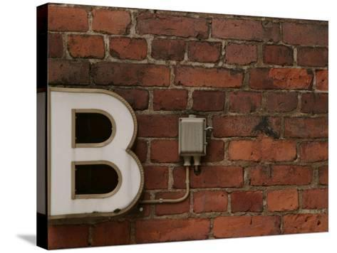 Florescent B Letter Light on Brick Wall--Stretched Canvas Print