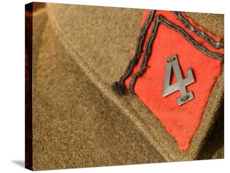 Patch with Number Sewn on Brown Fabric Background--Stretched Canvas Print