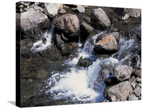 Rushing and Rapid River Stream over Rocks--Stretched Canvas Print