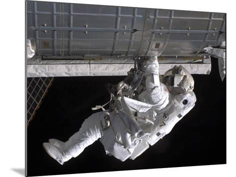 Astronaut Participates in Extravehicular Activity on the International Space Station-Stocktrek Images-Mounted Photographic Print