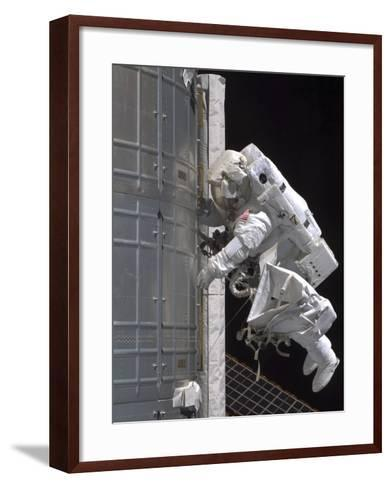 Astronaut Participates in Extravehicular Activity on the International Space Station-Stocktrek Images-Framed Art Print
