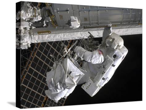 Astronaut Participates in Extravehicular Activity on the International Space Station-Stocktrek Images-Stretched Canvas Print
