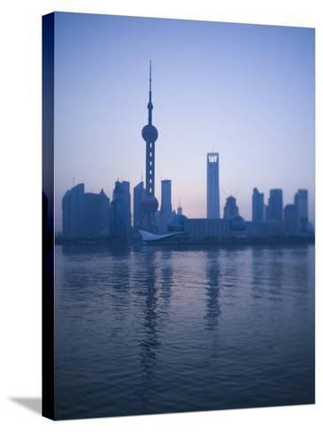 Pudong Skyline and Oriental Pearl Tower, Pudong District, Shanghai, China-Walter Bibikow-Stretched Canvas Print