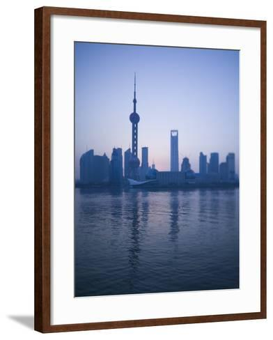 Pudong Skyline and Oriental Pearl Tower, Pudong District, Shanghai, China-Walter Bibikow-Framed Art Print