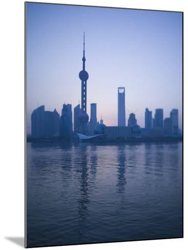 Pudong Skyline and Oriental Pearl Tower, Pudong District, Shanghai, China-Walter Bibikow-Mounted Photographic Print