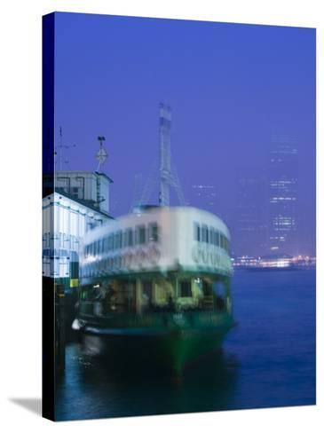 Victoria Harbour, Star Ferry Terminal, Kowloon, Hong Kong, China-Walter Bibikow-Stretched Canvas Print
