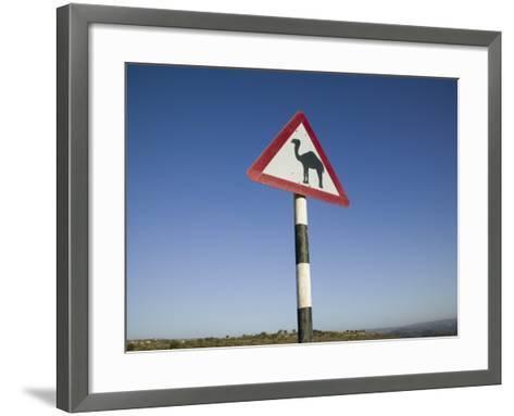Oman, Dhofar Region, Salalah, Camel Crossing Sign in the Dhofar Mountains-Walter Bibikow-Framed Art Print