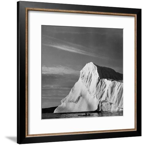 Native Man in Kayak Sitting in Water Next to Iceberg--Framed Art Print