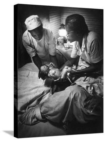 African American Midwife Maude Callen Delivering a Baby-W^ Eugene Smith-Stretched Canvas Print