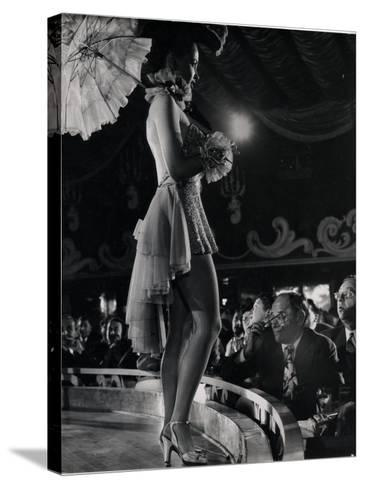 Patron at Stage-Side Table Looks Appraisingly at Tall Show Girl Standing at Edge of Stage-Gjon Mili-Stretched Canvas Print