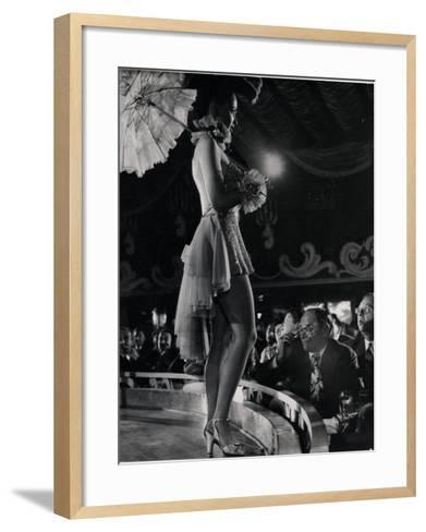 Patron at Stage-Side Table Looks Appraisingly at Tall Show Girl Standing at Edge of Stage-Gjon Mili-Framed Art Print