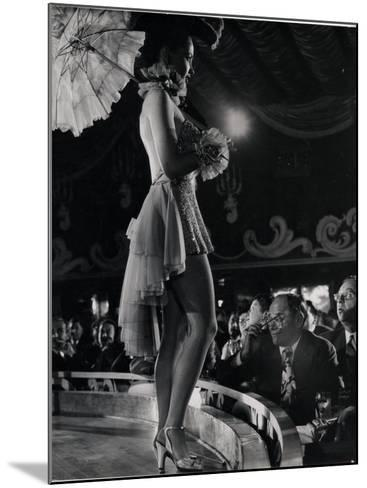 Patron at Stage-Side Table Looks Appraisingly at Tall Show Girl Standing at Edge of Stage-Gjon Mili-Mounted Photographic Print