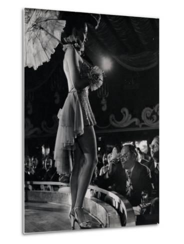 Patron at Stage-Side Table Looks Appraisingly at Tall Show Girl Standing at Edge of Stage-Gjon Mili-Metal Print