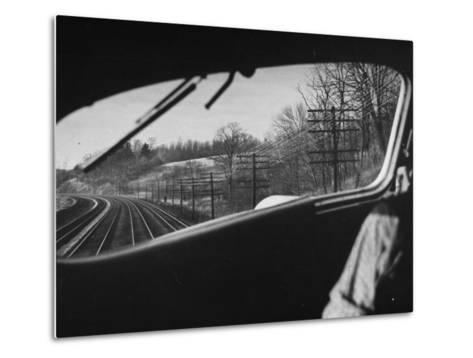 View Looking at the Railroad Tracks from the Front Window of the Train-Peter Stackpole-Metal Print