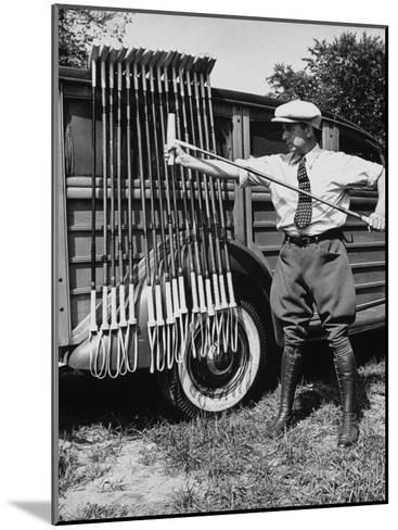 Polo Player Checking the Mallets-Alfred Eisenstaedt-Mounted Photographic Print
