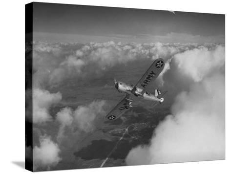 US Army's Ryan, Dragonfly, YO-51 Observation Plane Soaring Above the Clouds-Peter Stackpole-Stretched Canvas Print