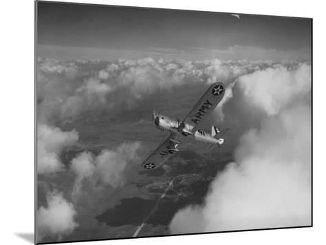 US Army's Ryan, Dragonfly, YO-51 Observation Plane Soaring Above the Clouds-Peter Stackpole-Mounted Photographic Print