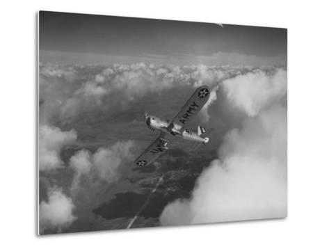 US Army's Ryan, Dragonfly, YO-51 Observation Plane Soaring Above the Clouds-Peter Stackpole-Metal Print