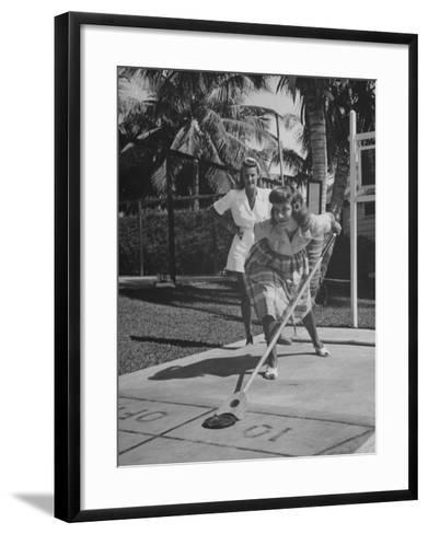 Wives of Men in the US Army and Navy Playing Shuffleboard-Peter Stackpole-Framed Art Print