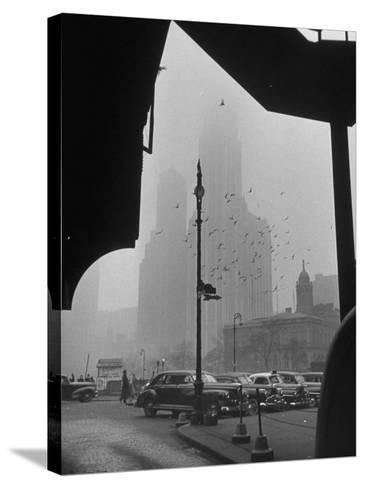 Surrounding the City in Fog, with City Hall and Woolworth Building in Background-Walter Sanders-Stretched Canvas Print