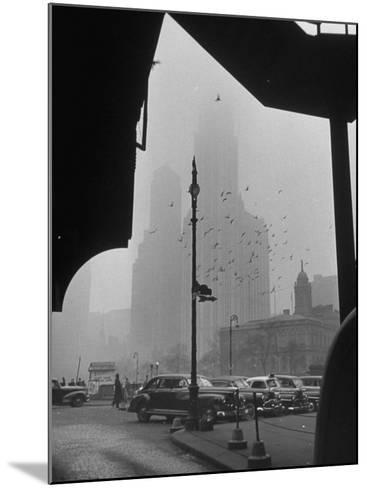 Surrounding the City in Fog, with City Hall and Woolworth Building in Background-Walter Sanders-Mounted Photographic Print