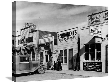 Beauty Parlor Advertising: Permanents: $3.50, $5.00 and $6.50, Shack Town, Fort Peck Dam-Margaret Bourke-White-Stretched Canvas Print