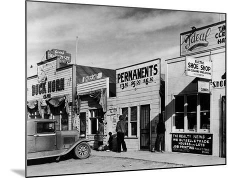 Beauty Parlor Advertising: Permanents: $3.50, $5.00 and $6.50, Shack Town, Fort Peck Dam-Margaret Bourke-White-Mounted Photographic Print